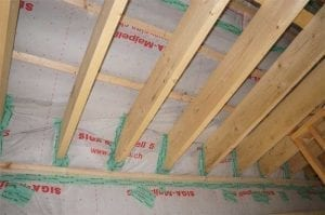 Roof joists coming through airtight membrane and sealed with airtight tape around each roof joist